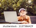 an asian schoolboy is using a... | Shutterstock . vector #1137386429
