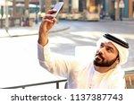 arab man taking selfie in... | Shutterstock . vector #1137387743