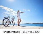attractive woman in white... | Shutterstock . vector #1137463520