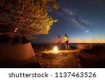night camping at lake under... | Shutterstock . vector #1137463526