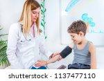 pediatrician measuring boy s... | Shutterstock . vector #1137477110