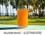 a glass of orange juice is... | Shutterstock . vector #1137481430