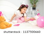 lovely girl playing around with ... | Shutterstock . vector #1137500660