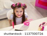 beautiful kid with hair curlers.... | Shutterstock . vector #1137500726