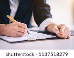 secretary in suit at workspace... | Shutterstock . vector #1137518279