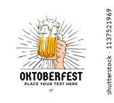 oktoberfest hand holding beer... | Shutterstock .eps vector #1137521969
