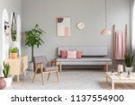 sofa with pastel pink cushions... | Shutterstock . vector #1137554900