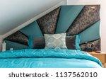 interior of  bedroom in loft... | Shutterstock . vector #1137562010