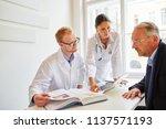 doctors with senior patient in... | Shutterstock . vector #1137571193