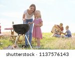 young woman with daughter... | Shutterstock . vector #1137576143