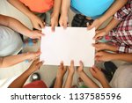 little children holding sheet... | Shutterstock . vector #1137585596