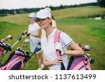 smiling women in caps with golf ... | Shutterstock . vector #1137613499