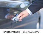 man in formalwear open car door ...   Shutterstock . vector #1137620399
