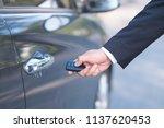 man in formalwear open car door ...   Shutterstock . vector #1137620453