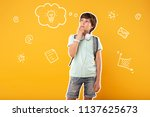 thoughtful boy. concentrated... | Shutterstock . vector #1137625673