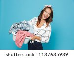 Stock photo portrait of young housekeeper s carrying laundry basket with dirty or clean clothes isolated over 1137635939