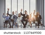 group of business people raise... | Shutterstock . vector #1137669500
