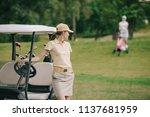 selective focus of female golf... | Shutterstock . vector #1137681959