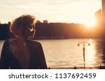 woman watching the sunset in a... | Shutterstock . vector #1137692459
