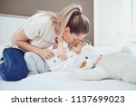 mother with baby lying on the... | Shutterstock . vector #1137699023