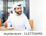 middle eastern man enjoying... | Shutterstock . vector #1137703490