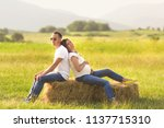 young pregnant woman with her... | Shutterstock . vector #1137715310