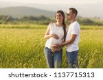 young pregnant woman with her... | Shutterstock . vector #1137715313