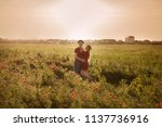 handsome couple hugging in a... | Shutterstock . vector #1137736916