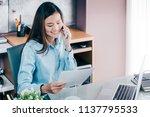asian businesswoman talking on... | Shutterstock . vector #1137795533