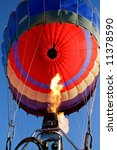 Close-up view of a colorful hot air balloon being inflated with hot air - stock photo