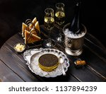 black caviar on ice in silver... | Shutterstock . vector #1137894239
