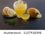 bottle of limoncello and lemons ... | Shutterstock . vector #1137918398