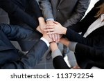 Small photo of Team work concept. Business people joining hands.