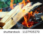 firewood burning in the brazier.... | Shutterstock . vector #1137935270