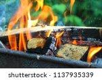 firewood burning in the brazier.... | Shutterstock . vector #1137935339