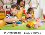 preschool children and teacher... | Shutterstock . vector #1137940913
