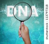 DNA , word in Magnifying glass on medical background - stock photo