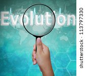 Evolution , word in Magnifying glass on medical background - stock photo