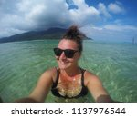 young happy tourist woman... | Shutterstock . vector #1137976544