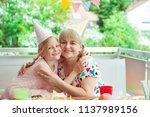 portrait of happy grandmother... | Shutterstock . vector #1137989156