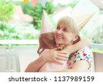 portrait of happy grandmother... | Shutterstock . vector #1137989159