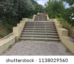 the long staircase descends... | Shutterstock . vector #1138029560