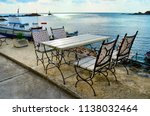 cozy restaurant with wooden... | Shutterstock . vector #1138032464