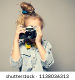 child with camera. little girl... | Shutterstock . vector #1138036313
