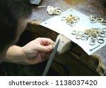 jeweler at work in jewelery... | Shutterstock . vector #1138037420