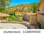 a narrow street in the spanish... | Shutterstock . vector #1138044530