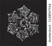 white snowflake on black... | Shutterstock .eps vector #1138047416