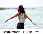 beautiful girl in the sea beach ... | Shutterstock . vector #1138053794