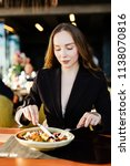 young woman eating healthy food ... | Shutterstock . vector #1138070816