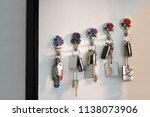 bundle of keys hanging on wall... | Shutterstock . vector #1138073906